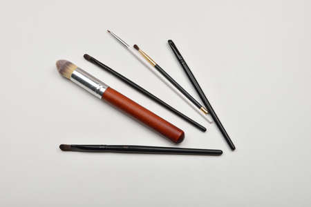 Picture of professional makeup brushes on white background