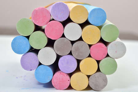 white chalks: Close up of chalks in a variety of colors arranged in circle on a white background. Back to school,education, arts, creative