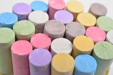 white chalks: Macro picture of chalks in a variety of colors on a white background. Drawing rainbow. Back to school,education, arts, creative
