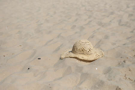 Summer at the beach, sun hat on the sand at beautiful beach. Vacation concept