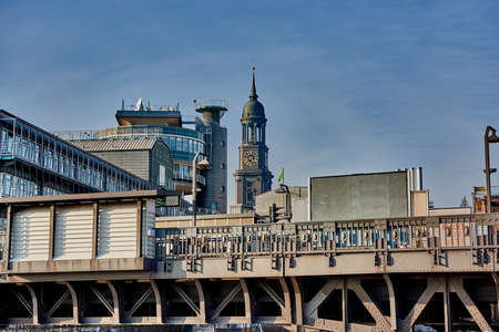 headquarter: HAMBURG, GERMANY - MARCH 26, 2016: View at elevated railway station, Gruner and Jahr headquarter building and the tower of the famous Michel in Hamburg.