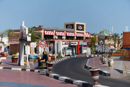 sharm el sheik: SHARM EL SHEIK, EGYPT - AUGUST 29, 2015: Small shopping mall shines in vivid colors against the sky Editorial