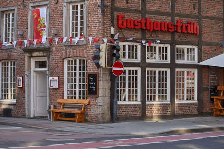hosts: NEUSS, GERMANY - AUGUST 08, 2016: Historic building hosts a traditional tavern at a street corner