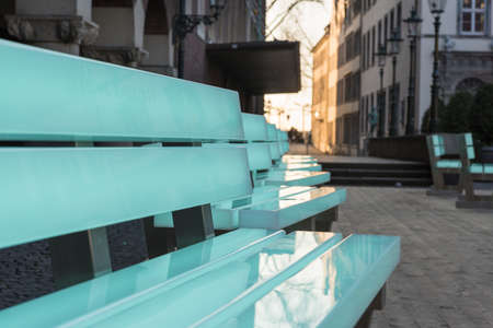 DUESSELDORF, GERMANY - FEBRUARY 13, 2017: Eighteen illuminated benches by the artist Bernd Spiecker decorate the Old market during the city program Grand Depart - changing their colours permanently. Editorial