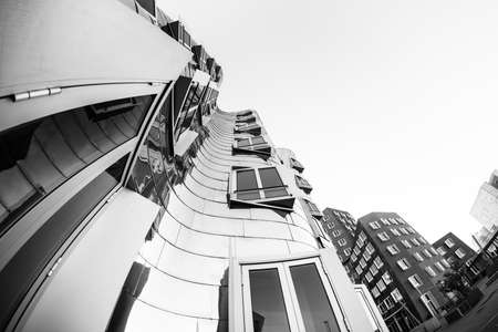 DUESSELDORF, GERMANY - JANUARY 22, 2017: The famous Chrome-Building in the New Media Harbor taken by a Fish Eye Camera in Black White. Editorial