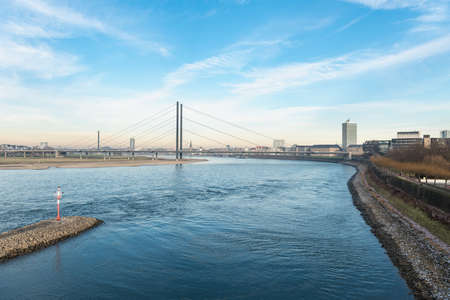 DUESSELDORF, GERMANY - JANUARY 20, 2017: From one of the skywalks in the new media harbor one has a spectacular view down the river Rhine on the local parliament of NRW and the skyline of the old town.
