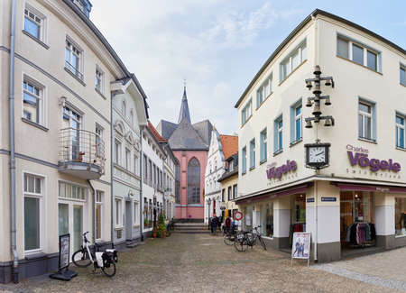 resides: KEMPEN, GERMANY - OCTOBER 26, 2016: The central church resides between narrow lshopping anes