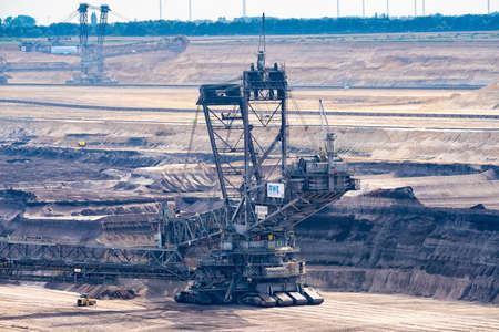 GARZWEILER, GERMANY - SEPTEMBER 01, 2016: Huge Excavator mines in an opencast mining field