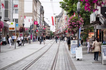 NEUSS, GERMANY - AUGUST 08, 2016: Pedestrants walk along a city shopping street