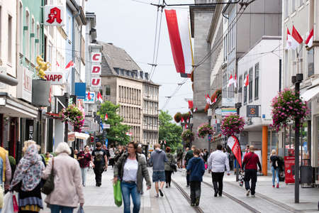 NEUSS, GERMANY - AUGUST 08, 2016: Pedestrants walking along a city shopping street