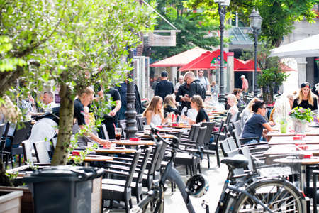 NEUSS, GERMANY - AUGUST 08, 2016: Visitors enjoy a restaurant with food and drinks