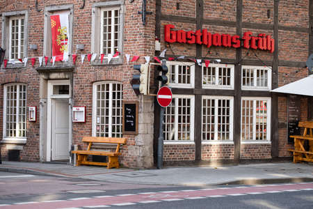 NEUSS, GERMANY - AUGUST 08, 2016: Historic building hosts a traditional tavern at a street corner
