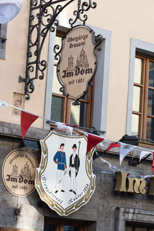 NEUSS, GERMANY - AUGUST 08, 2016: Signs indicate the age of a historic building Sajtókép