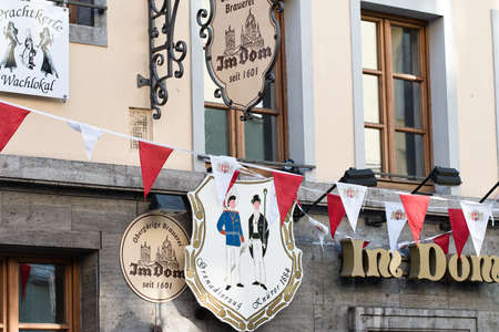 NEUSS, GERMANY - AUGUST 08, 2016: Signs indicate the age of a historic building