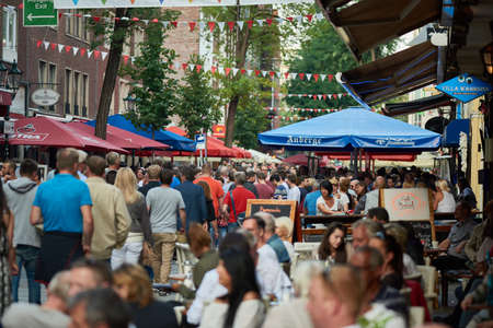 DUESSELDORF, GERMANY - AUGUST 06, 2016: Bars and restaurants are well populated by visitors and tourists in the Old Town