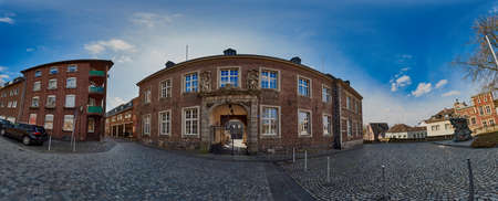 Moenchengladbach, Germany - March 09, 2016: Panorama view into Abteistrasse with old church administration buildings made of brick stones Editorial