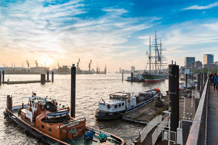 towed: Hamburg, Germany - November 01, 2015: Ships towed at the quay of river Elbe attract unidentified tourists and visitors Editorial