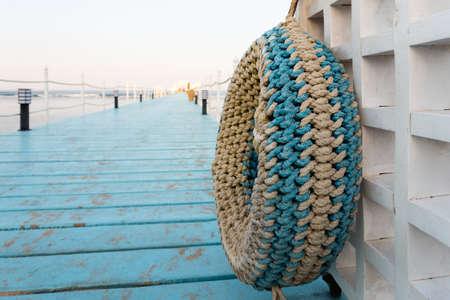 sharm el sheik: RIXOS SHARM EL SHEIK, EGYPT - AUGUST 25, 2015: Pier into the blue sea with traditional fender