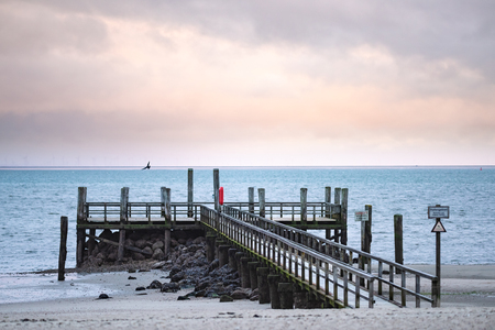 Pier at the beach of Wyk on the German Island of Foehr in cold November