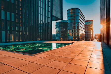 Duesseldorf, GERMANY - January 20, 2019: Modern architecture of New Harbour City throws long and dramatic shadows during sunset captured