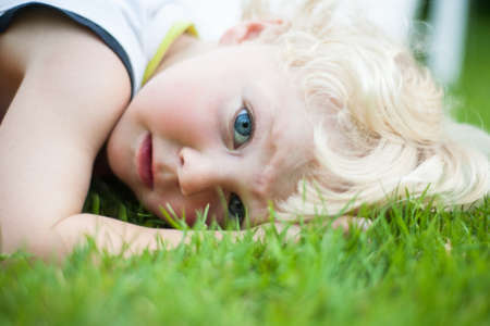 blond boy: Naturally blond hair and deep blue eyes Stock Photo