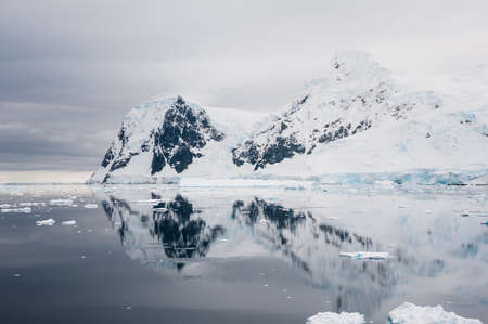 Dramatic snowcap hill in Antarctica photo
