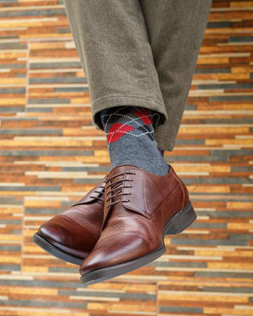 men's feet in a beautiful pair of shoes and socks Banque d'images