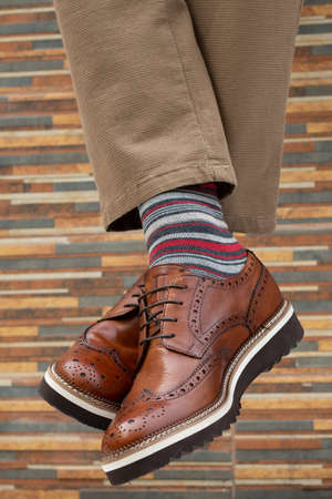 fashionable mens shoes with feet in socks Reklamní fotografie