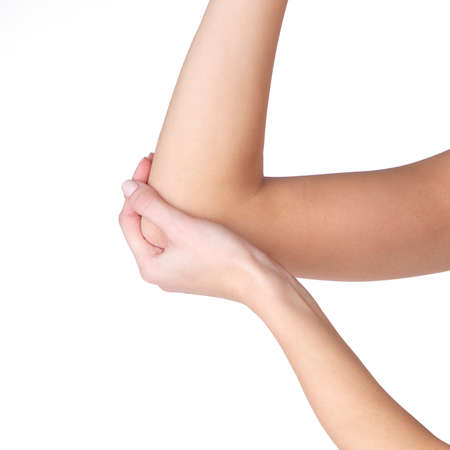 Save Download Preview Closeup woman hand holding elbow with pain on white background, health care and medical concept. Stockfoto