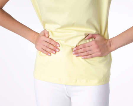 Young beautiful woman having painful stomachache on white background.Chronic gastritis. Abdomen bloating concept
