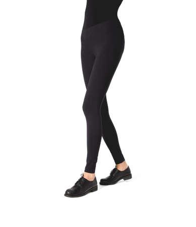 Woman wear black blank leggings mockup. Women in clear leggins template. Cloth pants design presentation. Sport pantaloons stretch tights model wearing. Slim legs in apparel