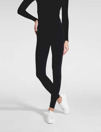 Woman wear black blank leggings mockup. Women in clear leggins template. Cloth pants design presentation. Sport pantaloons stretch tights model wearing. Slim legs in apparel.