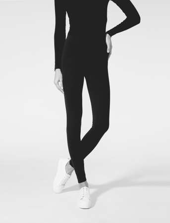 Woman wear black blank leggings mockup, ,  . Women in clear leggins template. Cloth pants design presentation. Sport pantaloons stretch tights model wearing. Slim legs in apparel. 免版税图像