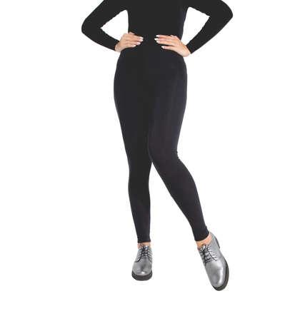 Woman wear black blank leggings mockup . Women in clear leggins template. Cloth pants design presentation. Sport pantaloons stretch tights model wearing. Slim legs in apparel.