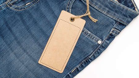 Label price tag mockup on blue jeans from recycled paper