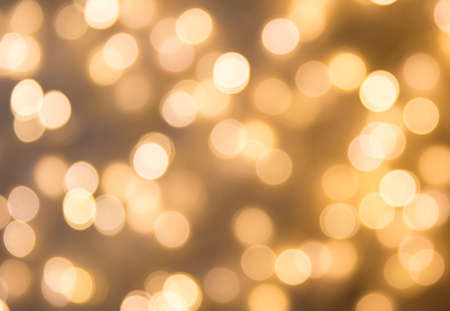blurred many of bokeh photography in abstract background yellow color theme photo taken from led panel