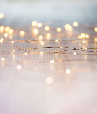 Christmas lights on background with copy space. Decorative garland 免版税图像
