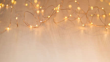 Christmas lights on background with copy space. Decorative garland. High quality photo