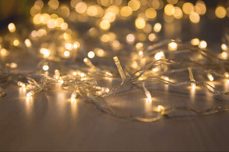 Christmas lights on dark background with copy space. Decorative garland