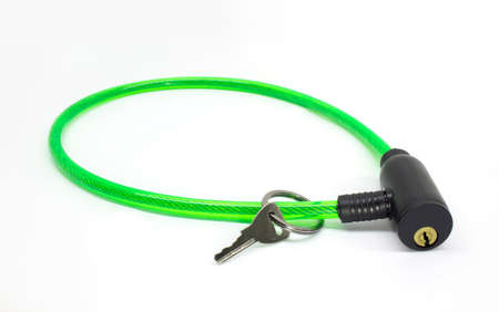 Green bike cable lock with key isolated on white background