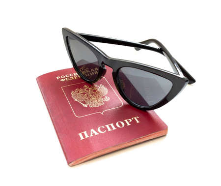 Russian passport and sunglasses isolated on white background. Close-up photo. Travel concept. Foto de archivo