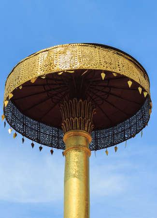 tiered: Golden Tiered Umbrella