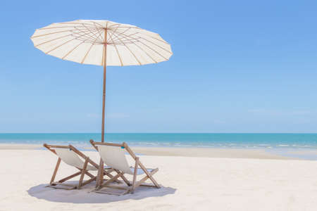 Idyllic tropical beach with white sand, turquoise ocean water and blue sky in huahin thailand