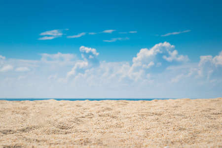 view of empty tropical sand beach with puffy white cloud and blue sky background Фото со стока