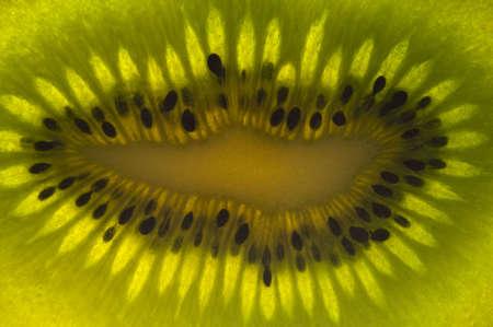 kiwi fruit close up showing the seeds and flesh of the fruit Stock Photo
