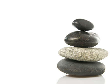 A stack of four stone isolated on a white background