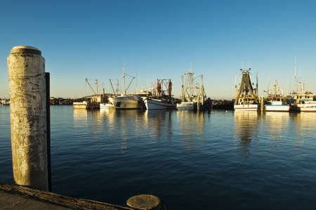 A vibrante image of fishing trawlers moored in a harbour Stock Photo