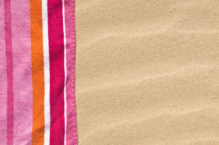 vibrant beach towel on the sand.