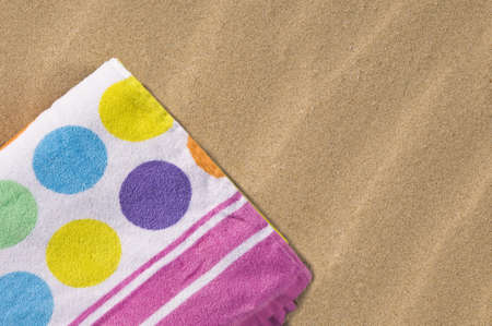 Spotted and folded towel on the sand.