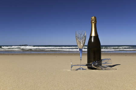 wedding beach: Bottle of champagne with two crystals glasses on a secluded beach